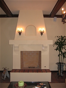 Spanish style stucco/plaster fireplace with Rumford style firebox and tiled hearth - Click here for larger view